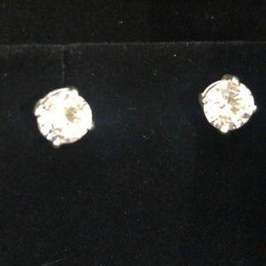 925 sterling silver cubic zirconium stud earrings.